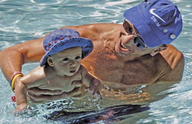 Infant enjoying her swim lesson